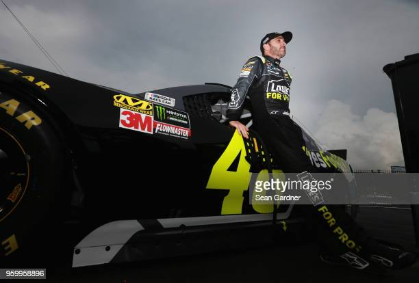 Jimmie Johnson driver of the Lowe's for Pros Chevrolet leans against his car during qualifying for the Monster Energy NASCAR Cup Series AllStar Race...