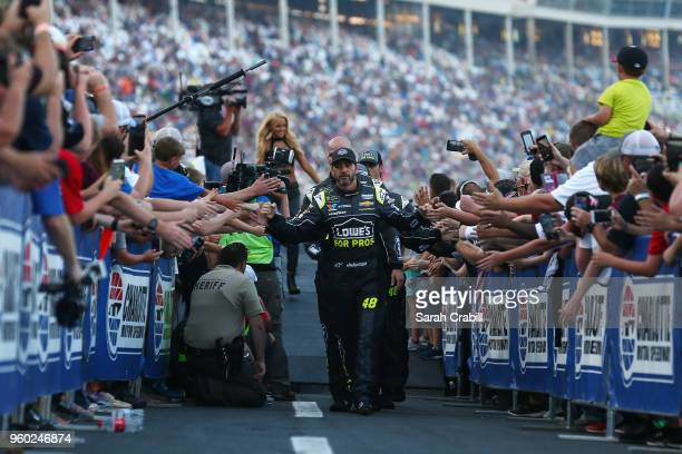Jimmie Johnson driver of the Lowe's for Pros Chevrolet participates in prerace ceremonies prior to the Monster Energy NASCAR Cup Series AllStar Race...