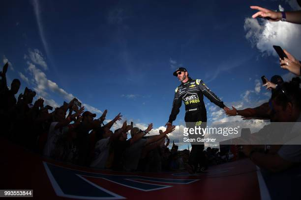 Jimmie Johnson driver of the Lowe's for Pros Chevrolet participates in pre race activities during the Monster Energy NASCAR Cup Series Coke Zero...