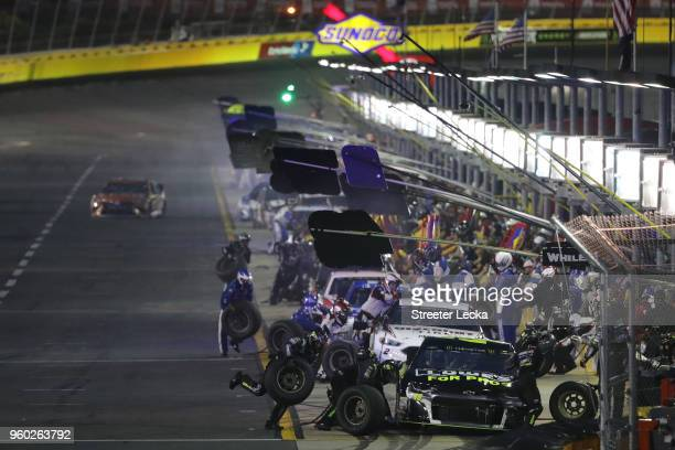 Jimmie Johnson driver of the Lowe's for Pros Chevrolet pits during the Monster Energy NASCAR Cup Series AllStar Race at Charlotte Motor Speedway on...
