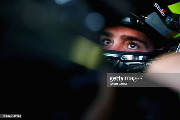 Jimmie Johnson driver of the Lowe's for Pros Chevrolet sits in his car during practice for the Monster Energy NASCAR Cup Series Gander Outdoors 400...