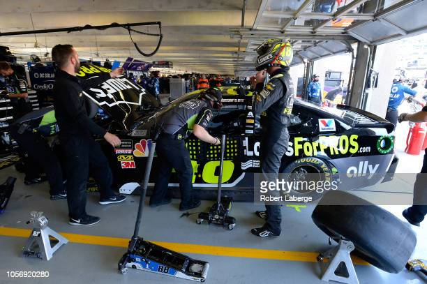 Jimmie Johnson driver of the Lowe's for Pros Chevrolet stands in the garage during practice for the Monster Energy NASCAR Cup Series AAA Texas 500 at...