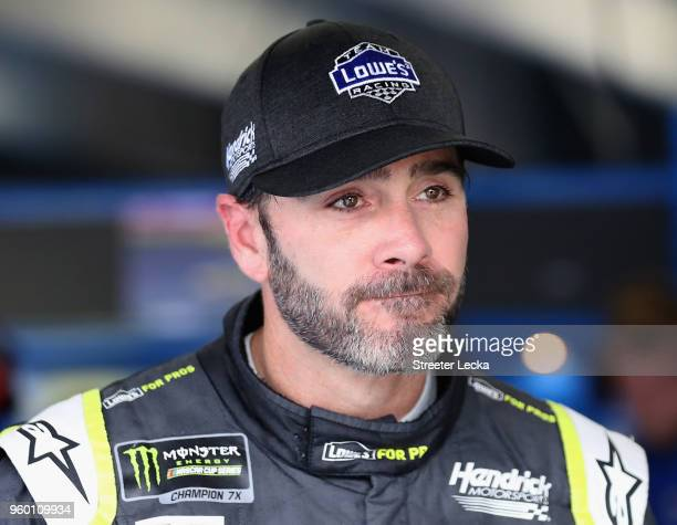 Jimmie Johnson driver of the Lowe's for Pros Chevrolet stands in the garage area during practice for the Monster Energy NASCAR Cup Series AllStar...