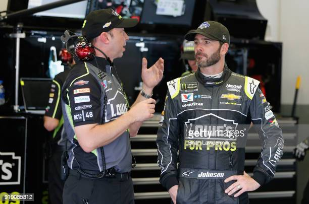 Jimmie Johnson driver of the Lowe's for Pros Chevrolet talks to his crew chief Chad Knaus during practice for the Monster Energy NASCAR Cup Series...