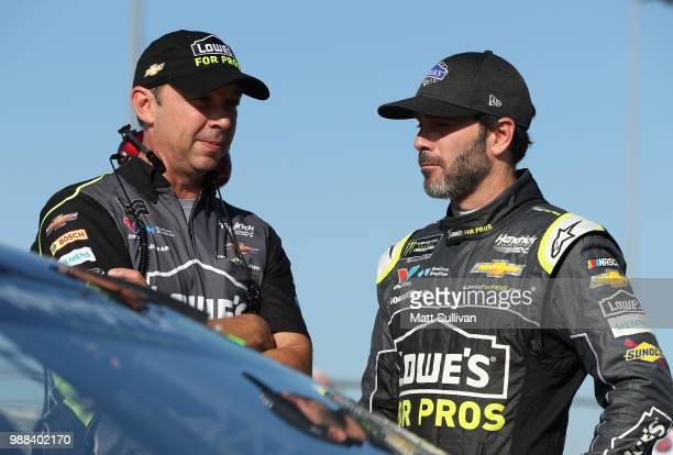 Jimmie Johnson driver of the Lowe's for Pros Chevrolet talks to his crew chief Chad Knaus during qualifying for the Monster Energy NASCAR Cup Series...