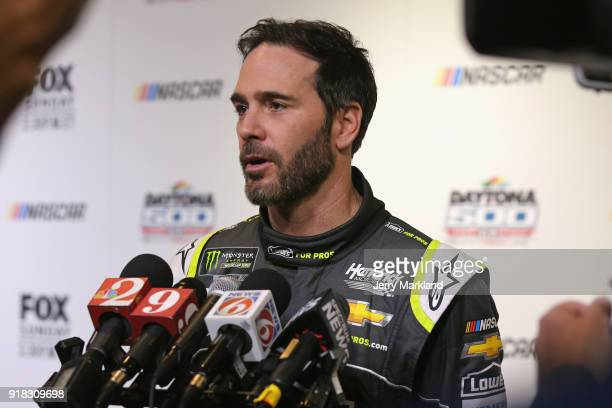 Jimmie Johnson driver of the Lowe's for Pros Chevrolet talks to the media during the Daytona 500 Media Day at Daytona International Speedway on...