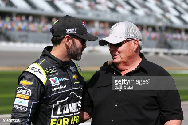 Jimmie Johnson driver of the Lowe's for Pros Chevrolet talks with team owner Rick Hendrick on the grid during qualifying for the Monster Energy...