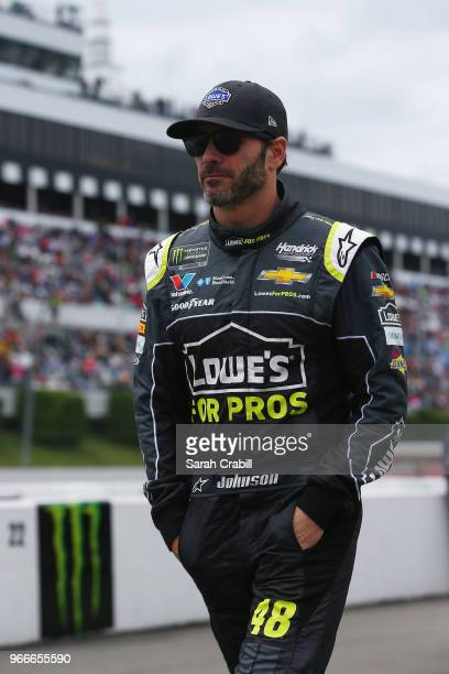 Jimmie Johnson driver of the Lowe's for Pros Chevrolet walks on pit road during prerace ceremonies before the Monster Energy NASCAR Cup Series Pocono...