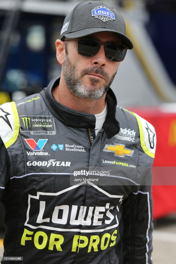Jimmie Johnson, driver of the #48 Lowe's for Pros Chevrolet, walks to his car during practice for the Monster Energy NASCAR Cup Series Consmers Energy 400 at Michigan International Speedway on August 10, 2018 in Brooklyn, Michigan.