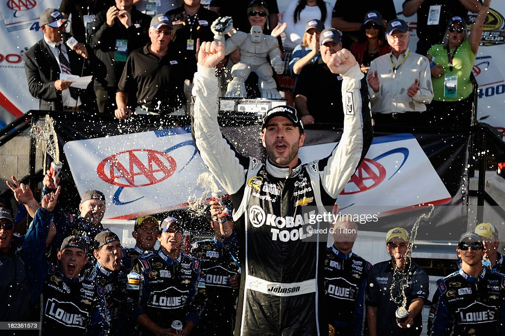 Jimmie Johnson, driver of the #48 Lowe's / Kobalt Tools Chevrolet, celebrates in Victory Lane after winning during the NASCAR Sprint Cup Series AAA 400 at Dover International Speedway on September 29, 2013 in Dover, Delaware.