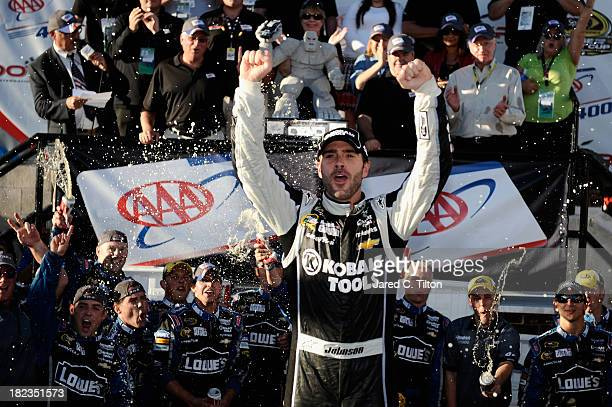 Jimmie Johnson driver of the Lowe's / Kobalt Tools Chevrolet celebrates in Victory Lane after winning during the NASCAR Sprint Cup Series AAA 400 at...