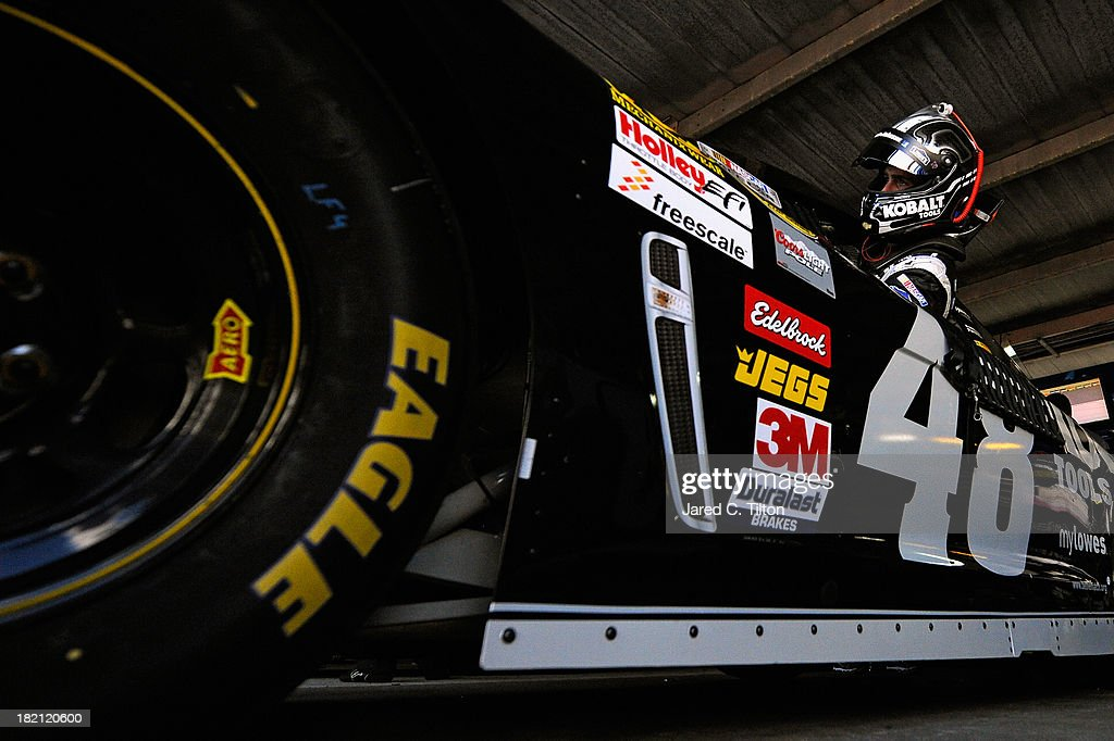 Jimmie Johnson, driver of the #48 Lowe's / Kobalt Tools Chevrolet, climbs in his car during practice for the NASCAR Sprint Cup Series AAA 400 at Dover International Speedway on September 28, 2013 in Dover, Delaware.