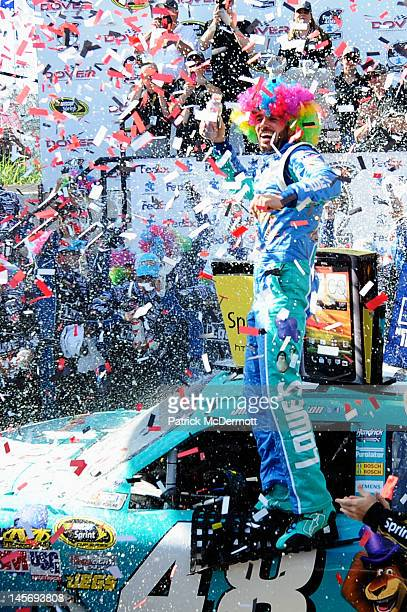 Jimmie Johnson driver of the Lowe's Madagascar Chevrolet celebrates in Victory Lane after winning the NASCAR Sprint Cup Series FedEx 400 benefiting...