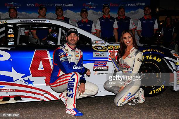 Jimmie Johnson driver of the Lowe's Patriotic Chevrolet and Miss Coors Light Amanda Mertz pose with the pole award after qualifying for the NASCAR...