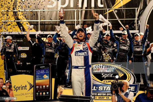 Jimmie Johnson driver of the Lowe's Patriotic Chevrolet celebrates in victory lane after winning the NASCAR Sprint AllStar Race at Charlotte Motor...