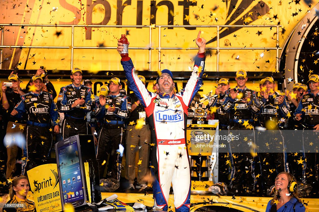 Jimmie Johnson, driver of the #48 Lowe's Patriotic Chevrolet, celebrates in Victory Lane after winning the NASCAR Sprint Cup Series All-Star race at Charlotte Motor Speedway on May 18, 2013 in Concord, North Carolina.