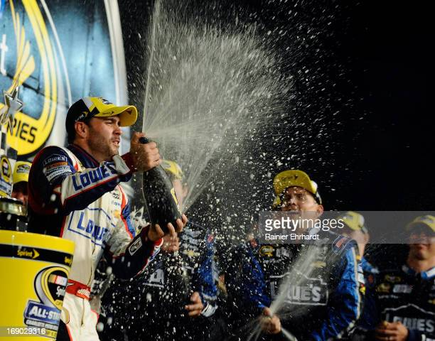Jimmie Johnson driver of the Lowe's Patriotic Chevrolet celebrates in Victory Lane after winning the NASCAR Sprint Cup Series AllStar race at...