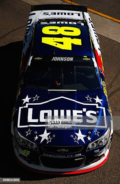 Jimmie Johnson driver of the Lowe's Patriotic Chevrolet drives through the garage area during practice for the NASCAR Sprint Cup Series Quicken Loans...