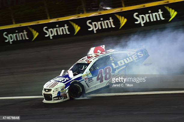 Jimmie Johnson driver of the Lowe's Patriotic Chevrolet has an on track incident during the NASCAR Sprint Cup Series CocaCola 600 at Charlotte Motor...