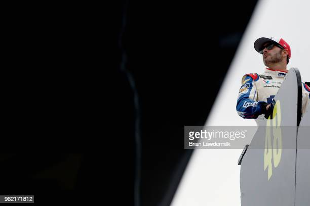 Jimmie Johnson driver of the Lowe's Patriotic Chevrolet looks on from the top of his team hauler during practice for the Monster Energy NASCAR Cup...