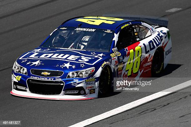 Jimmie Johnson driver of the Lowe's Patriotic Chevrolet practices for the NASCAR Sprint Cup Series Sprint AllStar Race at Charlotte Motor Speedway on...