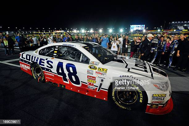 Jimmie Johnson driver of the Lowe's Patriotic Chevrolet pulls into Victory Lane after winning the NASCAR Sprint Cup Series AllStar race at Charlotte...