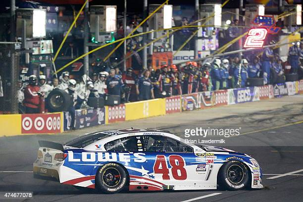 Jimmie Johnson driver of the Lowe's Patriotic Chevrolet sits on pit road after making contact with the inside wall during the NASCAR Sprint Cup...