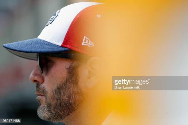 Jimmie Johnson driver of the Lowe's Patriotic Chevrolet stands in the garage area during practice for the Monster Energy NASCAR Cup Series CocaCola...