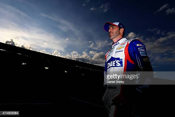 Jimmie Johnson driver of the Lowe's Patriotic Chevrolet walks on the grid during qualifying for the NASCAR Sprint Cup Series CocaCola 600 at...