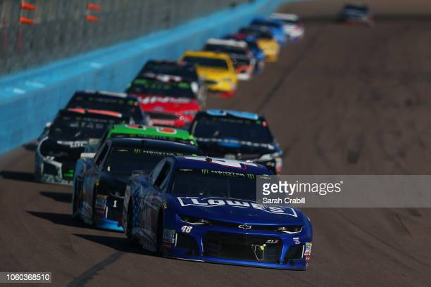 Jimmie Johnson driver of the Lowe's Power of Pride Chevrolet leads a group of cars during the Monster Energy NASCAR Cup Series CanAm 500 at ISM...