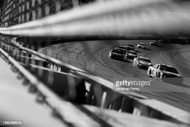 Jimmie Johnson driver of the Lowe's Power of Pride Chevrolet leads a pack of cars during the Monster Energy NASCAR Cup Series CanAm 500 at ISM...