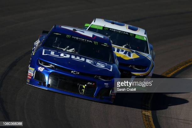 Jimmie Johnson driver of the Lowe's Power of Pride Chevrolet leads Chase Elliott driver of the NAPA Auto Parts Chevrolet during the Monster Energy...