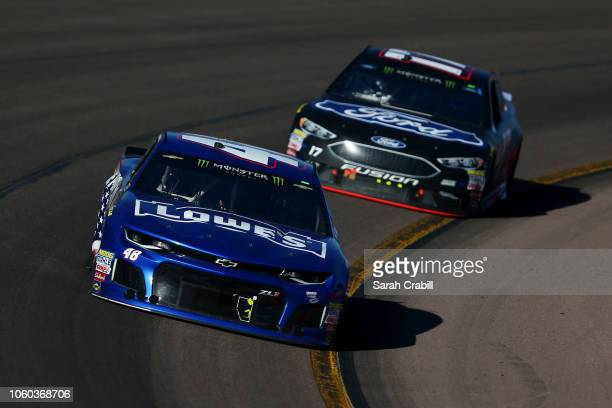 Jimmie Johnson driver of the Lowe's Power of Pride Chevrolet leads Ricky Stenhouse Jr driver of the Ford Ford during the Monster Energy NASCAR Cup...