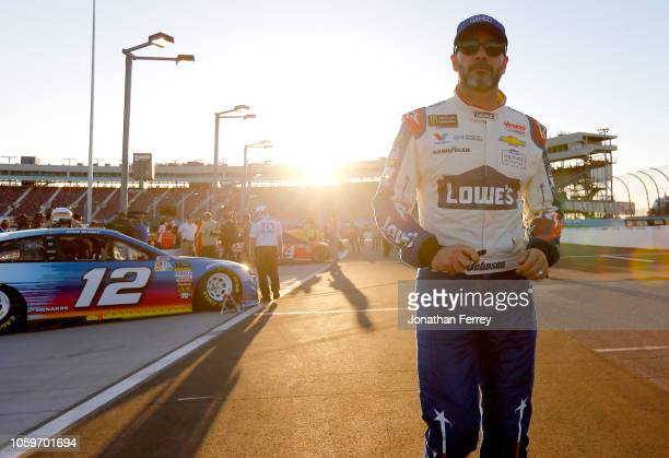 Jimmie Johnson, driver of the Lowe's Power of Pride Chevrolet, walks on the grid during qualifying for the Monster Energy NASCAR Cup Series Can-Am...