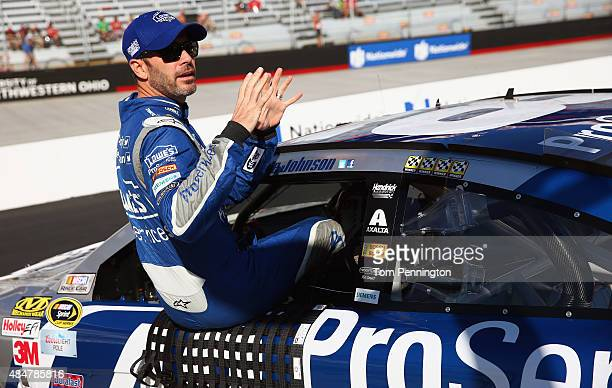 Jimmie Johnson driver of the Lowe's Pro Services Chevrolet climbs into his car during qualifying for the NASCAR Sprint Cup Series Irwin Tools Night...