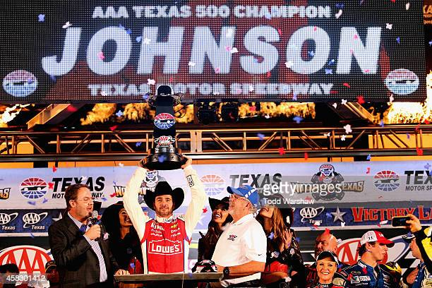 Jimmie Johnson driver of the Lowe's Red Vest Chevrolet celebrates with Texas Motor Speedway President Eddie Gossage and AAA VIP Employee Recognition...