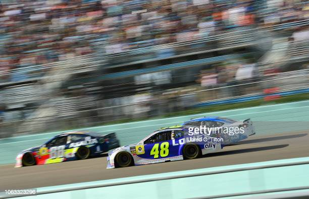 Jimmie Johnson driver of the Lowe's Rookie Throwback Chevrolet and Alex Bowman driver of the Axalta Chevrolet race during the Monster Energy NASCAR...
