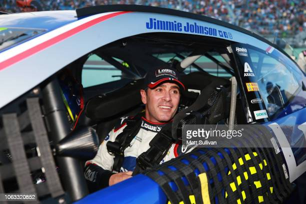 Jimmie Johnson driver of the Lowe's Rookie Throwback Chevrolet sits in his car on the grid during prerace ceremonies for Monster Energy NASCAR Cup...