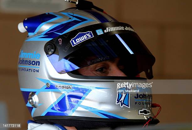 Jimmie Johnson driver of the Lowe's/Jimmie Johnson Foundation Chevrolet stands in the garage during practice for the NASCAR Sprint Cup Series Auto...