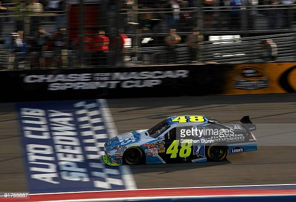 Jimmie Johnson driver of the Lowe's/Jimmie Johnson Foundation Chevrolet crosses the finsih line to win the NASCAR Sprint Cup Series Pepsi 500 at Auto...