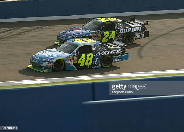 Jimmie Johnson driver of the Lowe's/Jimmie Johnson Foundation Chevrolet leads Jeff Gordon driver of the DuPont/Pepsi Chevrolet during the NASCAR...