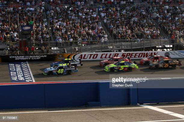 Jimmie Johnson driver of the Lowe's/Jimmie Johnson Foundation Chevrolet leads the field at the final restart of the NASCAR Sprint Cup Series Pepsi...