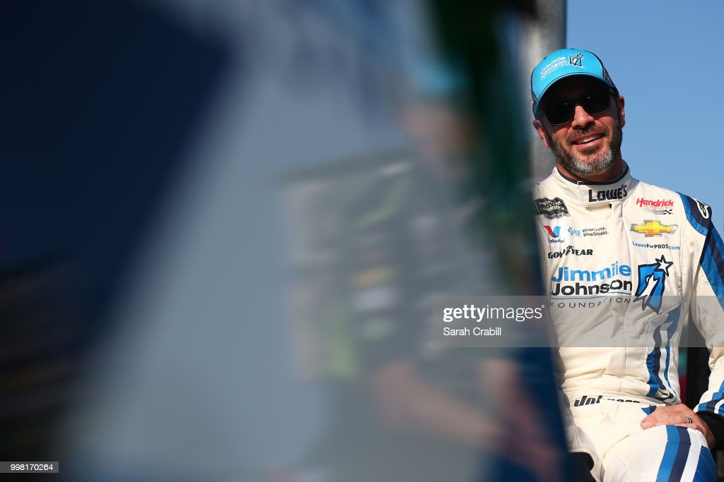 Jimmie Johnson, driver of the #48 Lowe's/Jimmie Johnson Foundation Chevrolet, stands on the grid during qualifying for the Monster Energy NASCAR Cup Series Quaker State 400 presented by Walmart at Kentucky Speedway on July 13, 2018 in Sparta, Kentucky.