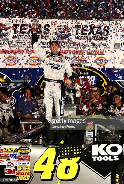 Jimmie Johnson driver of the Lowe's/Kobalt Chevrolet celebrates after winning the NASCAR Nextel Cup Series Dickies 500 at Texas Motor Speedway on...