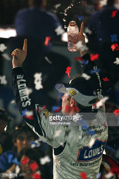 Jimmie Johnson driver of the Lowe's/Kobalt Chevrolet celebrates in victory lane after winning the NASCAR Nextel Cup Series Dickies 500 at Texas Motor...