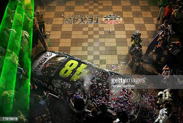 Jimmie Johnson driver of the Lowe's/Kobalt Chevrolet celebrates on victory lane after winning the NASCAR Nextel Cup Series Dickies 500 at Texas Motor...