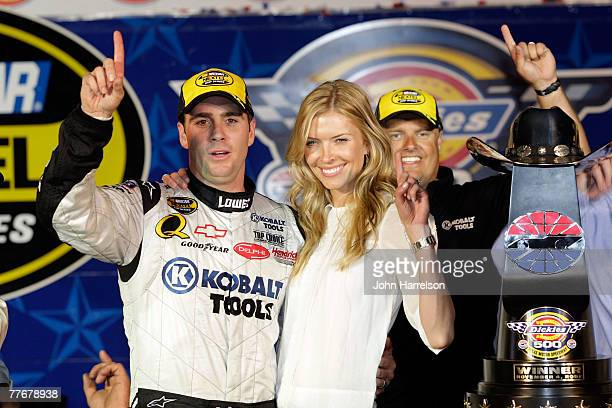 Jimmie Johnson driver of the Lowe's/Kobalt Chevrolet celebrates with his wife Chandra in victory lane during the NASCAR Nextel Cup Series Dickies 500...