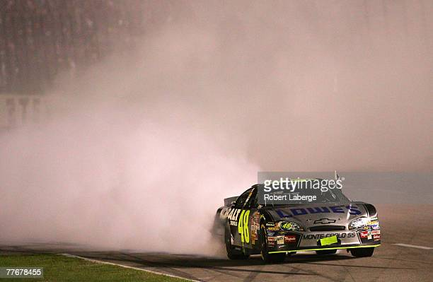 Jimmie Johnson driver of the Lowe's/Kobalt Chevrolet does a burnout after winning the NASCAR Nextel Cup Series Dickies 500 at Texas Motor Speedway on...