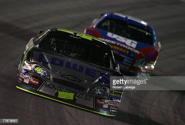 Jimmie Johnson driver of the Lowe's/Kobalt Chevrolet leads Matt Kenseth driver of the USG Ford during the NASCAR Nextel Cup Series Dickies 500 at...