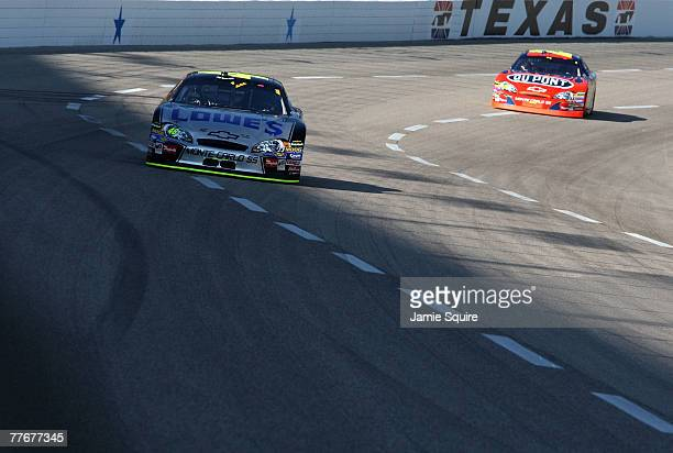 Jimmie Johnson driver of the Lowe's/Kobalt Chevrolet leads the race against Jeff Gordon driver of the DuPont Chevrolet during the NASCAR Nextel Cup...